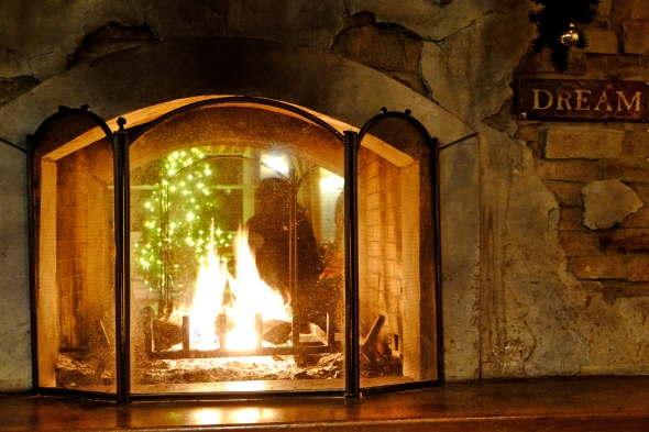 """Fire in Fireplace with """"Dream"""" Sign on Hearth"""