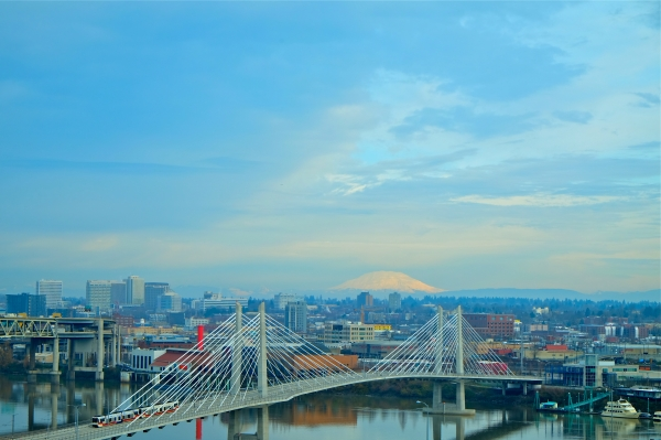 Portland, OR, Willamette River, Tilikum Crossing bridge and Mt. St. Helens on partly cloudy winter day