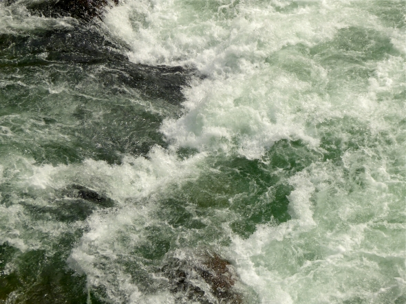 Wild whitewater rapids and green water in river