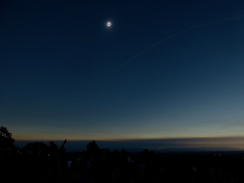 Total solar eclipse and distant mountains
