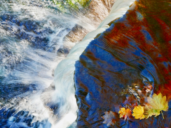 Small waterfall with autumn leaves