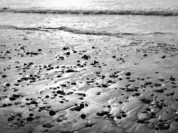 Beach with stones and surf