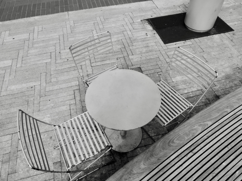 Circular table, chairs, bench and pavers