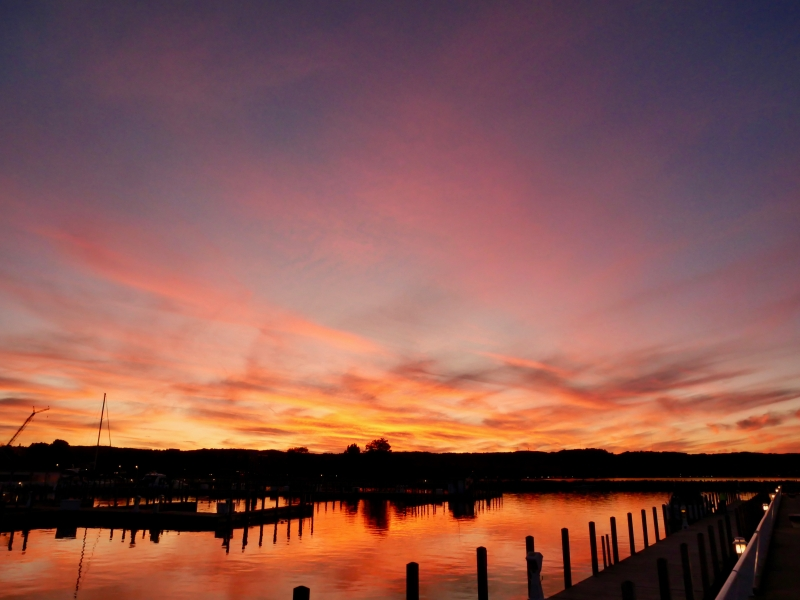 Colorful pastel sky and water after sunset at docks
