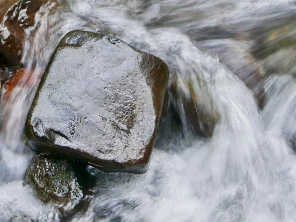 Rock stationary in whitewater creek