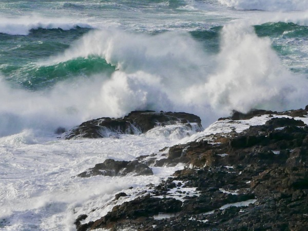 Big waves hitting rocky coastline