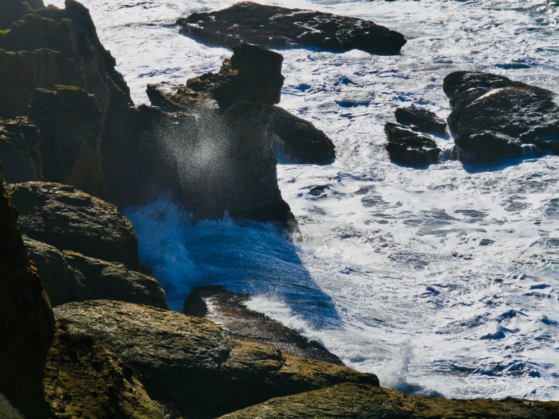 Waves hitting rocky coastline