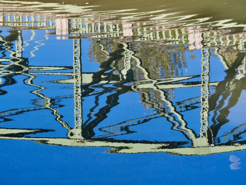 bridge reflected in river