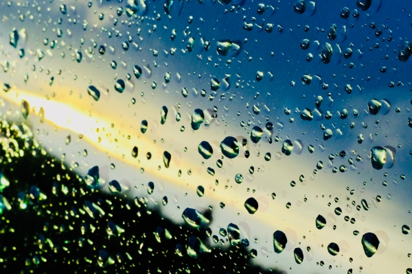 raindrops and reflections on car window