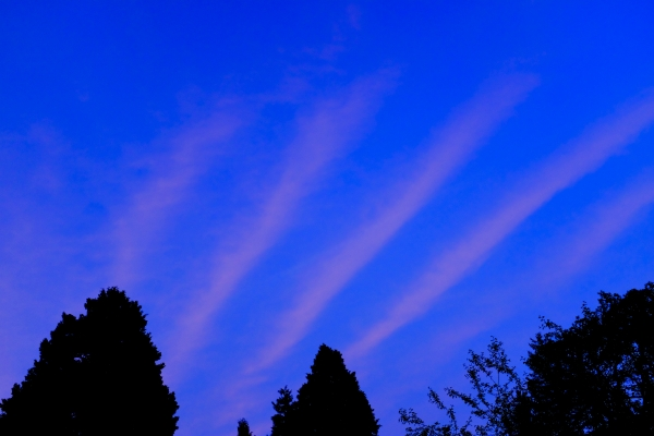 pink stripes in blue sky