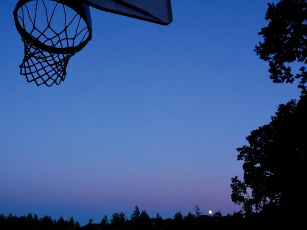 Basketball hoop and full moon rising
