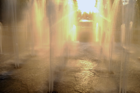 fountain backlit by setting sun