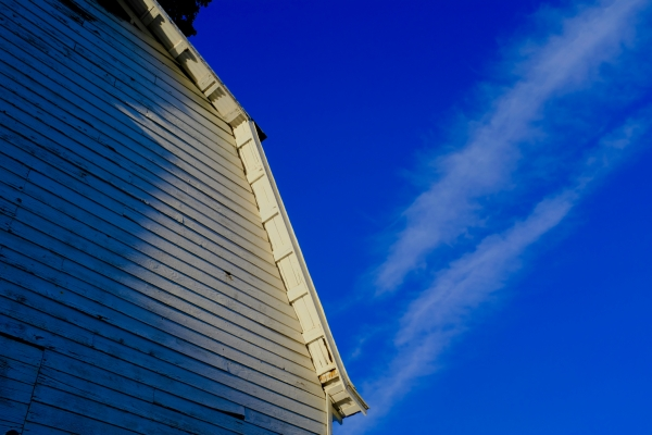 White barn and blue sky